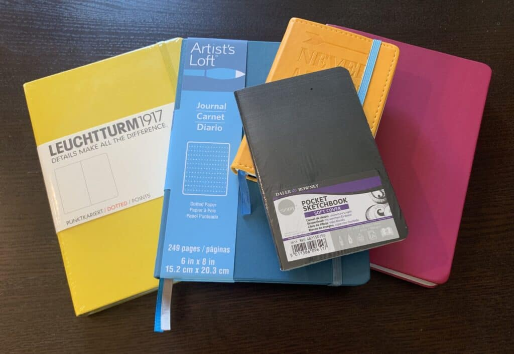 Different brands of notebooks in different sizes